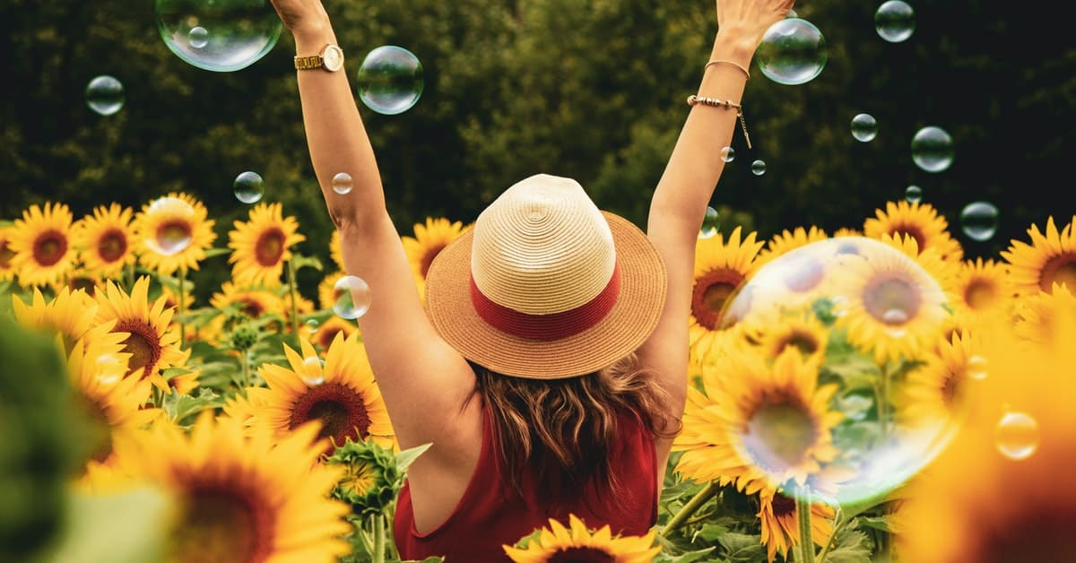 young lady happy with sunflower