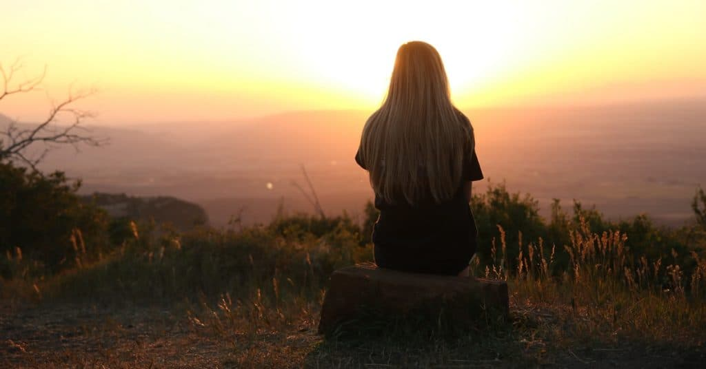 lady sitting in sunset